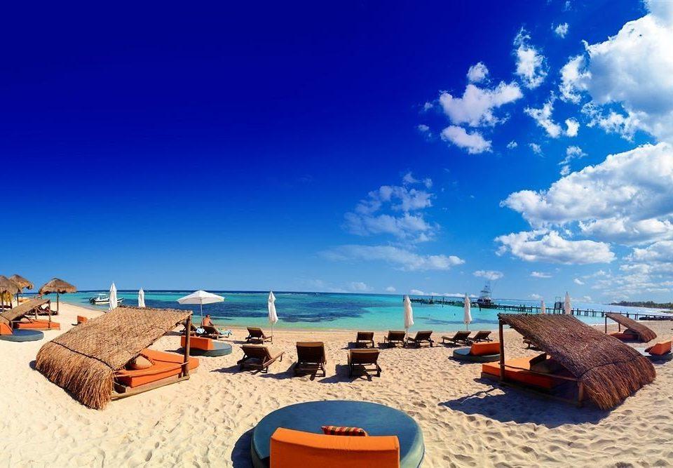 Beach Ocean Tropical sky umbrella chair leisure Sea swimming pool horizon Resort caribbean Coast Nature shore day