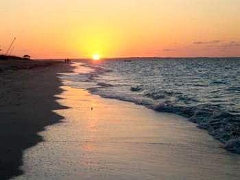 water Nature sky Sunset Beach Sun shore Ocean Sea Coast afterglow wind wave sunrise setting orange sandy