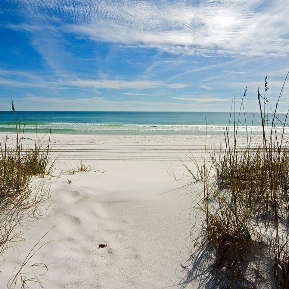Beach Ocean Outdoors sky water habitat shore Nature Sea horizon Coast cloud wave sand morning wind wave sunlight sandy