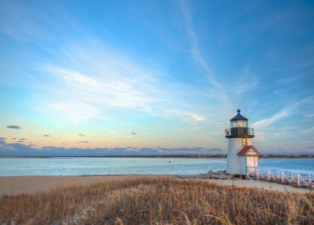 sky water grass tower lighthouse Nature horizon shore Sea Ocean Coast cloud Beach dusk dawn cape overlooking promontory