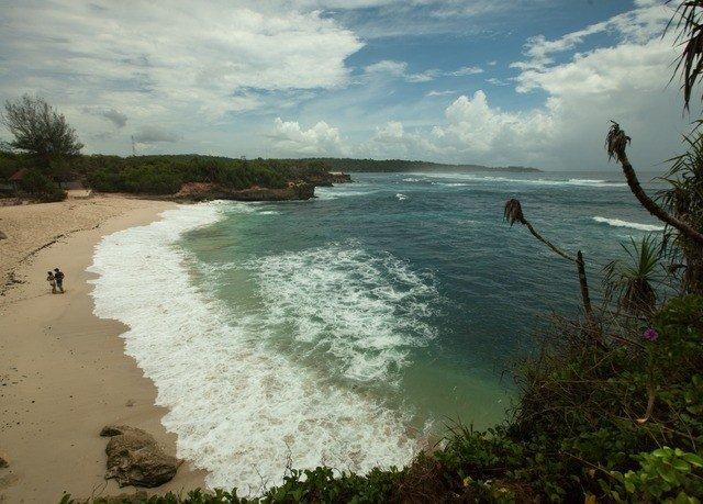 water sky Nature Beach shore Coast Sea Ocean wave cliff terrain cove sandy day