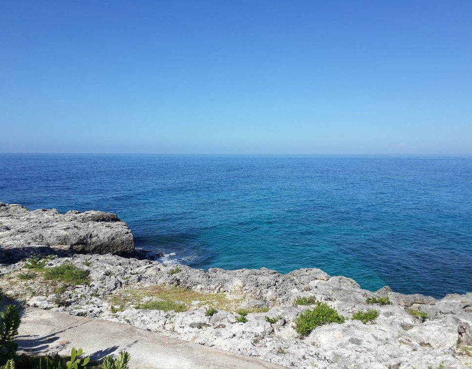 sky water Nature Coast Sea shore horizon headland Ocean promontory rocky cliff rock cape terrain cove Beach islet