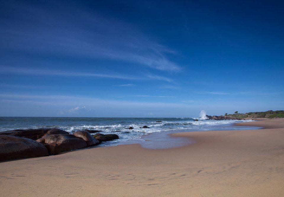 sky Beach water Nature shore Sea Ocean Coast horizon wave wind wave cloud sand cape dusk material sandy day distance