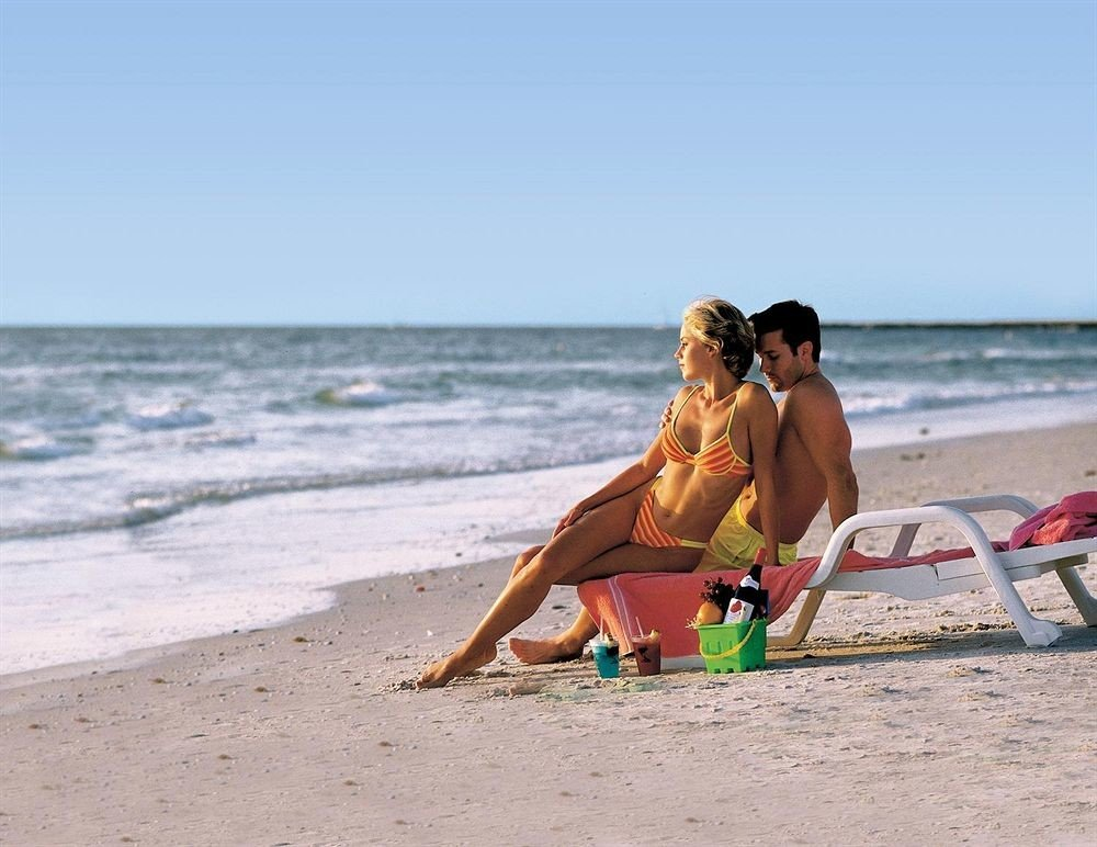 sky Beach water ground shore sun tanning Sea sand Coast Ocean Nature surfing equipment and supplies