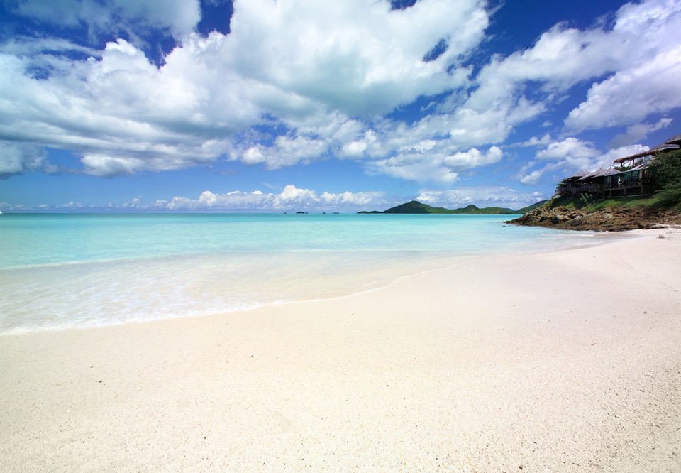 sky Beach water Nature Sea shore Ocean Coast horizon cloud sand caribbean wind wave wave cape tropics sandy clouds day