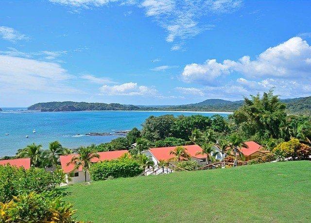 grass sky water property Nature Coast caribbean Resort Sea Beach cove overlooking lush beautiful shore