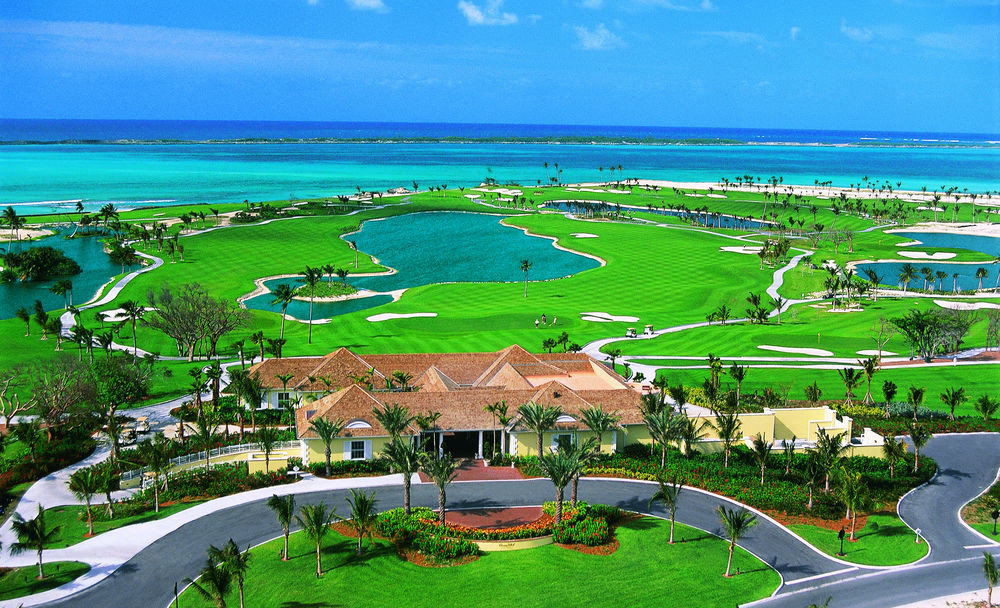 grass sky structure green Resort Nature sport venue caribbean Beach residential area golf course Coast marina lush