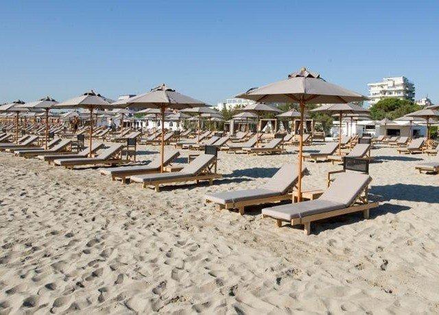 sky ground Beach sand sandy Resort shore Coast dock Nature marina Sea lined