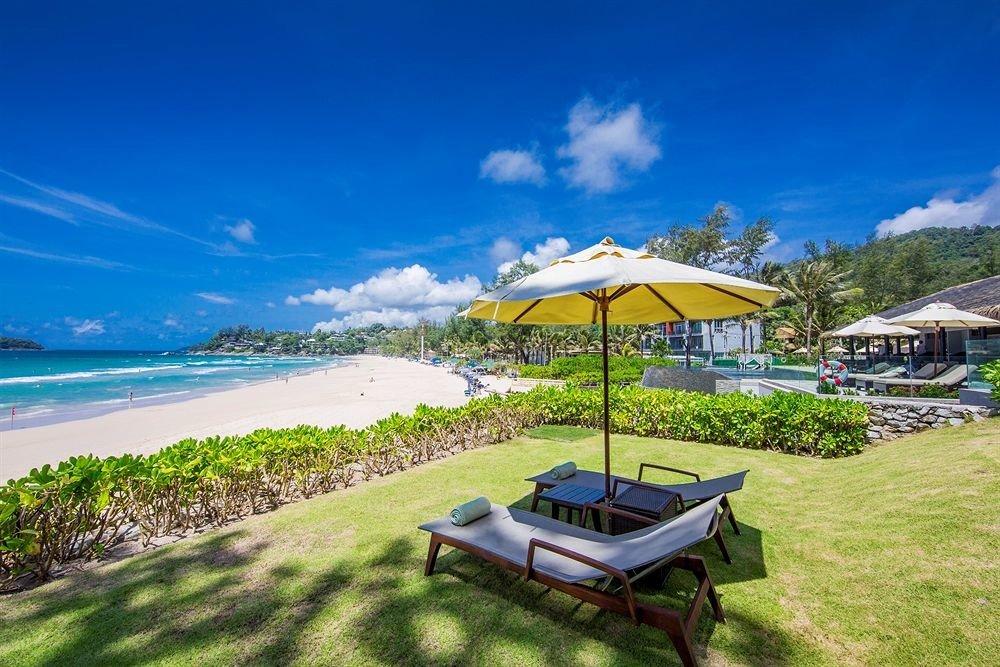 grass sky umbrella Nature chair lawn Beach Resort Coast caribbean Sea shore day