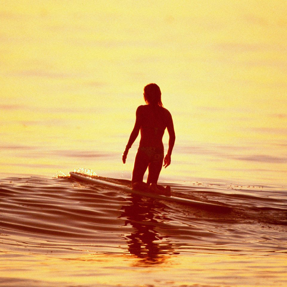 Beach Outdoor Activities Outdoors Play Scenic views water surfing man Sunset horizon Ocean Sea standing morning wave Coast sunrise sunlight sand silhouette