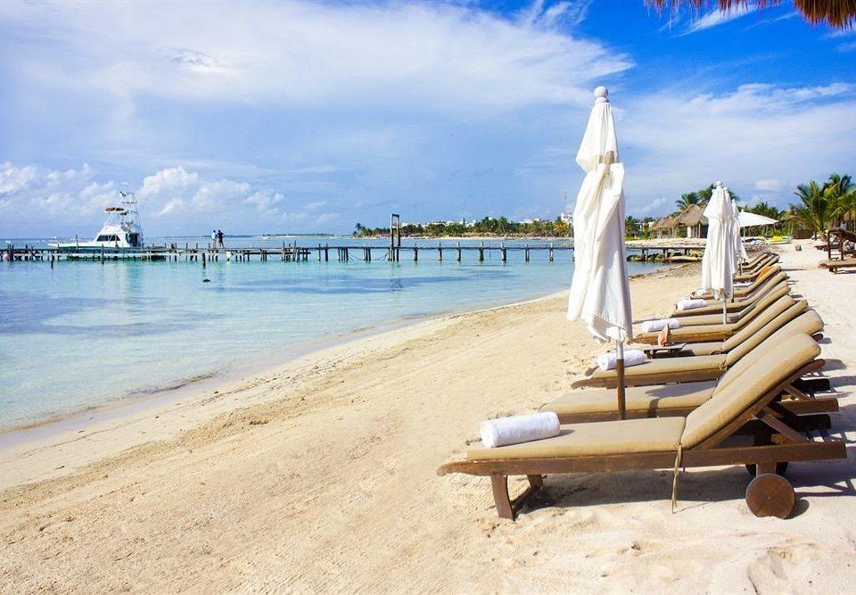 Beach Ocean Outdoors sky ground water shore leisure Sea Coast sand caribbean Resort dock walkway sandy