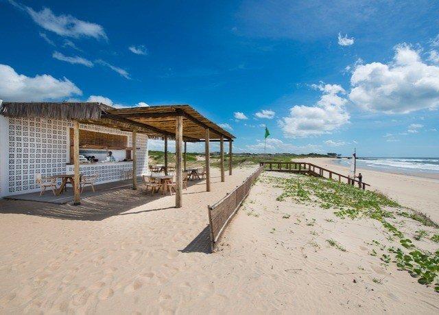 sky Beach property Sea shore walkway Coast Ocean sand Resort boardwalk sandy day