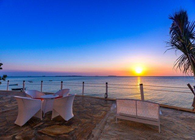 sky water Beach Ocean shore Sea horizon Coast caribbean Resort Sunset dusk sandy overlooking