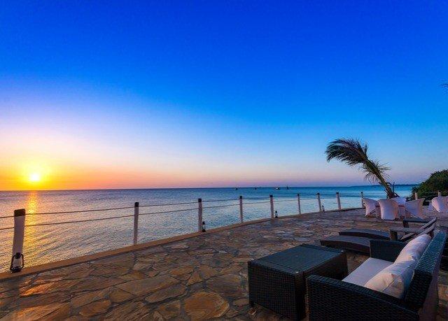 sky water scene Beach Ocean pier horizon Sea Coast Resort caribbean evening dusk Sunset palm sandy