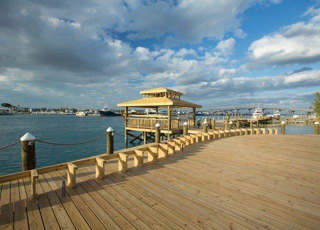 sky ground pier water Sea boardwalk walkway scene shore Beach Coast Ocean dock horizon wooden marina Resort vehicle cloudy overlooking day