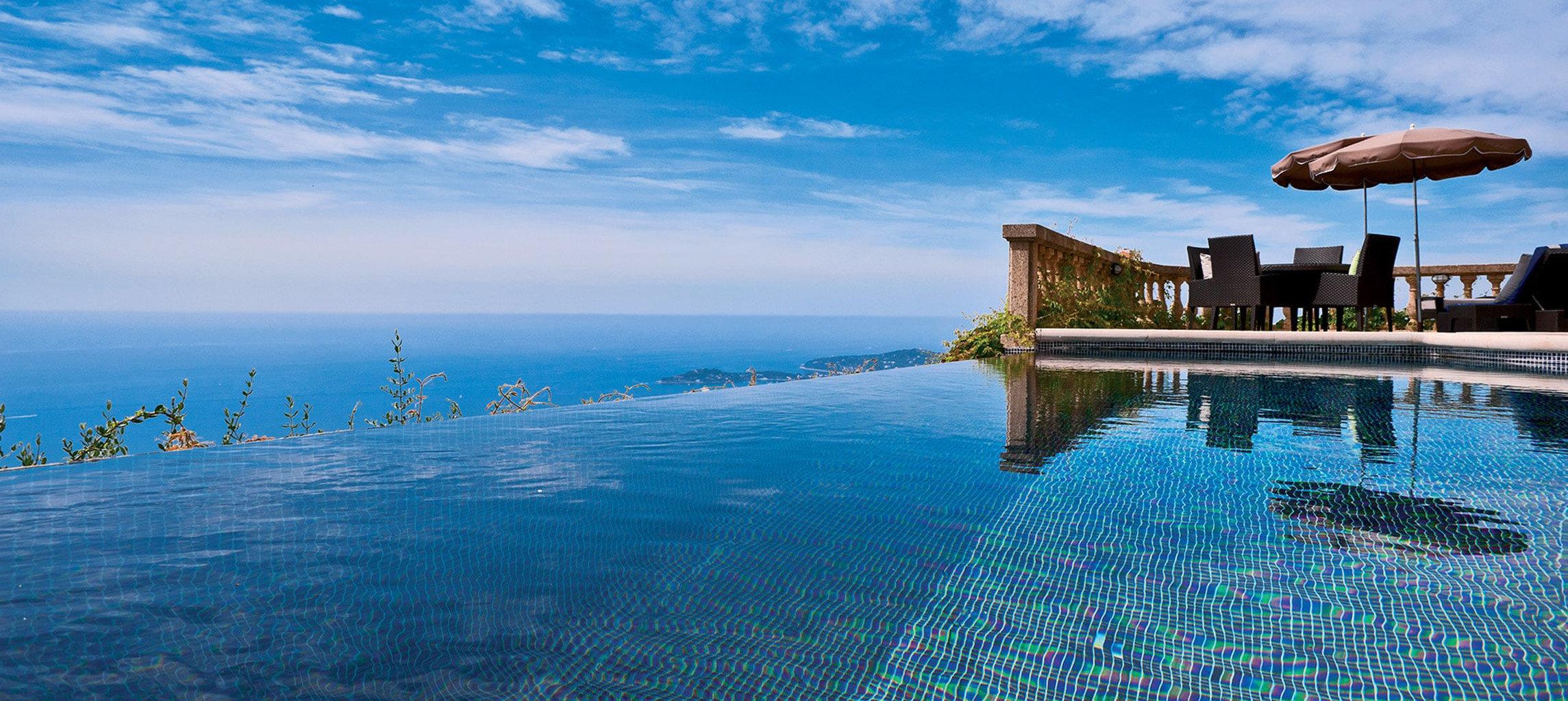 sky water Sea shore Ocean horizon swimming pool Coast Beach blue cape Resort day distance