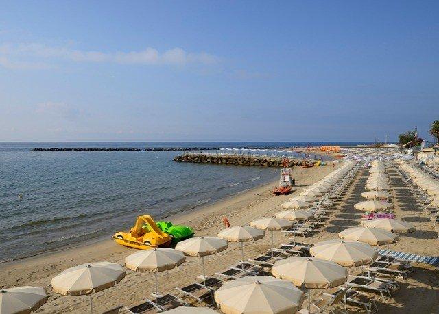 sky water Beach shore Sea Coast Ocean walkway sand cape boating Resort breakwater sandy