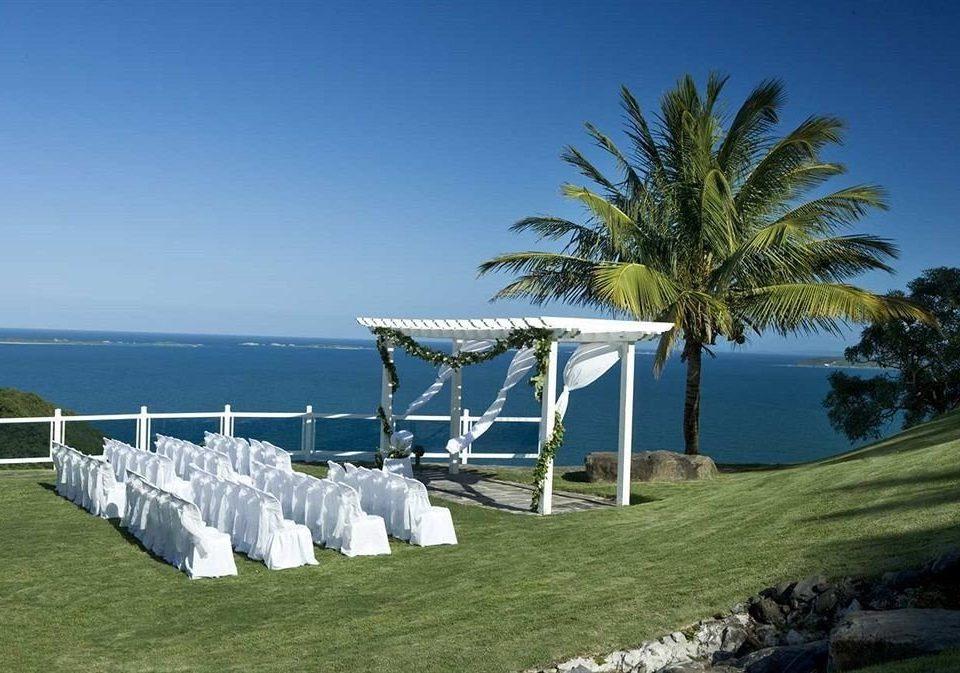 grass sky tree Beach Ocean Sea shore Coast Resort caribbean arecales Villa swimming pool palm