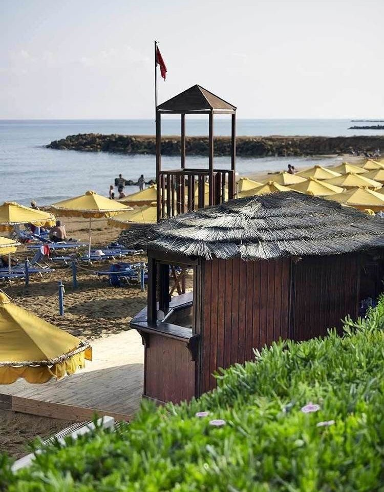 sky water Beach walkway Coast wooden shore Sea Ocean dock pier boardwalk tower Resort lined sandy