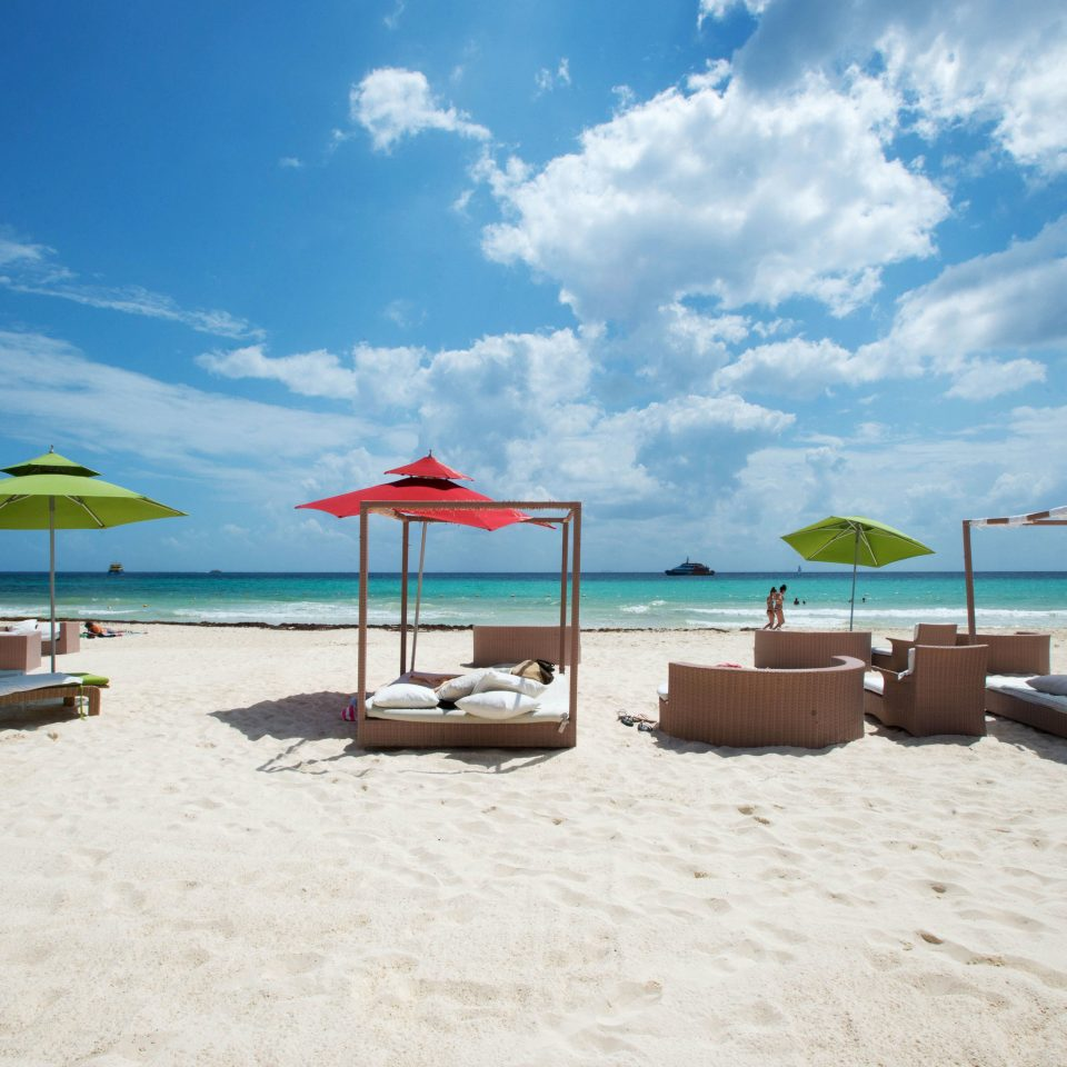 sky ground umbrella Beach leisure Sea Ocean sandy shore Resort caribbean Coast sand day shade