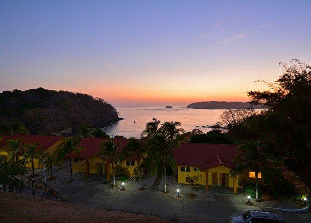 sky Beach Sunset Sea evening dusk Coast morning Ocean dawn Resort clouds distance