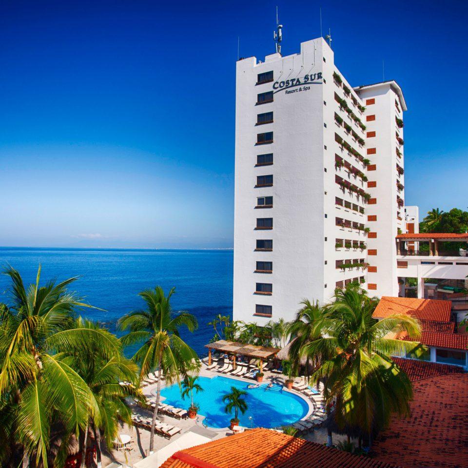 sky tree leisure Beach Resort landmark caribbean Ocean Sea Coast condominium arecales marina tower palm colorful shore