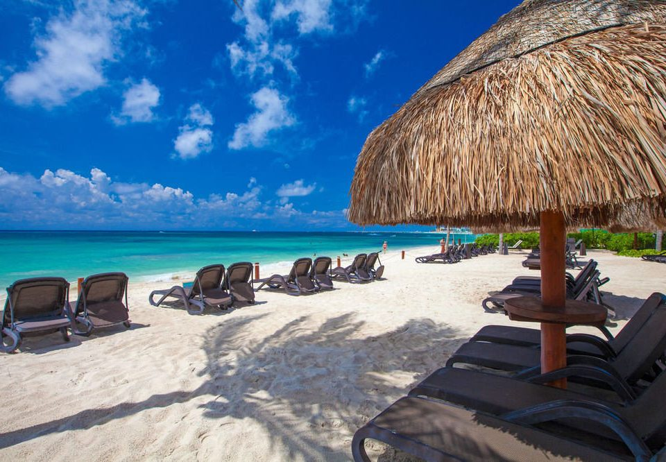 sky Beach chair Sea Ocean Coast Resort caribbean hut shore sandy day shade