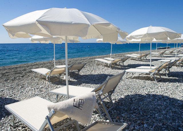 umbrella sky ground chair Beach lawn marina Sea shore Ocean Coast dock Resort wind set shade empty lined day sandy
