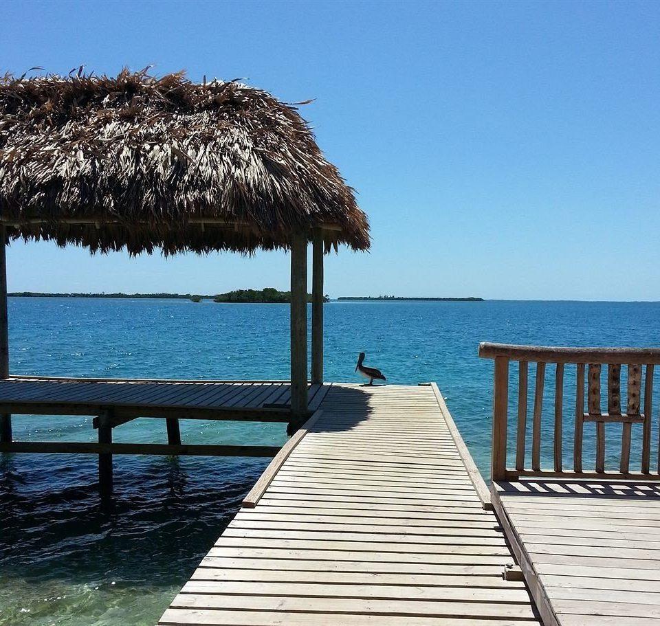 sky water umbrella chair Sea pier Beach Ocean shore walkway Coast Resort boardwalk dock caribbean day lined