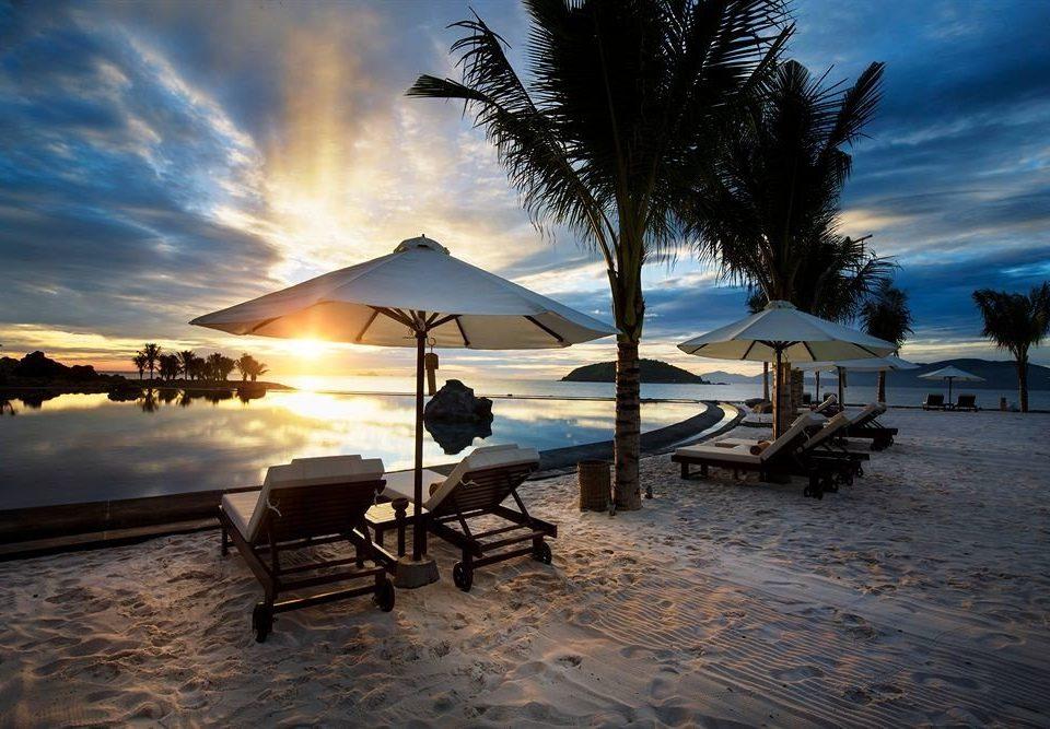 sky Beach Sea Sunset Ocean evening morning shore dusk sunlight sunrise Coast Sun dawn Resort sandy lined