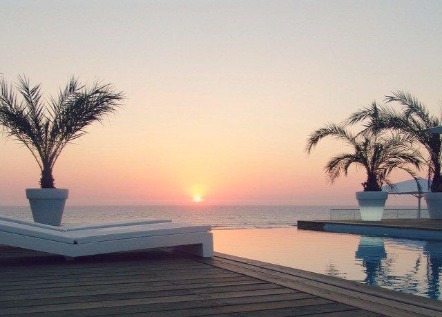 sky water horizon Sunset Ocean sunrise Sea morning Sun Beach arecales evening dusk Coast dawn sunlight setting set shore