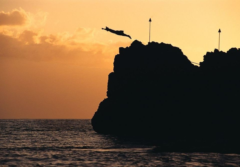 sky water Sunset Sea Coast horizon Ocean shore dawn sunrise cloud morning Sun rock dusk wave evening Beach silhouette cliff dark sunlight tower cape terrain distance clouds