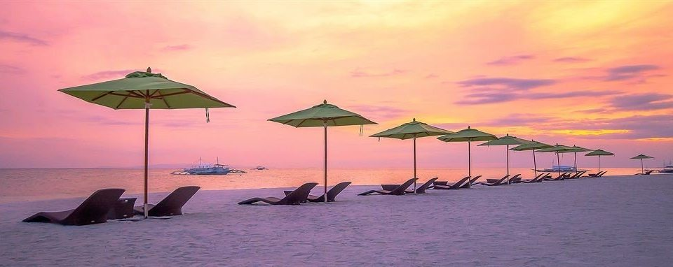 water umbrella chair Beach Sea Ocean Sunset dusk Coast evening dawn row wind sunrise lined line day