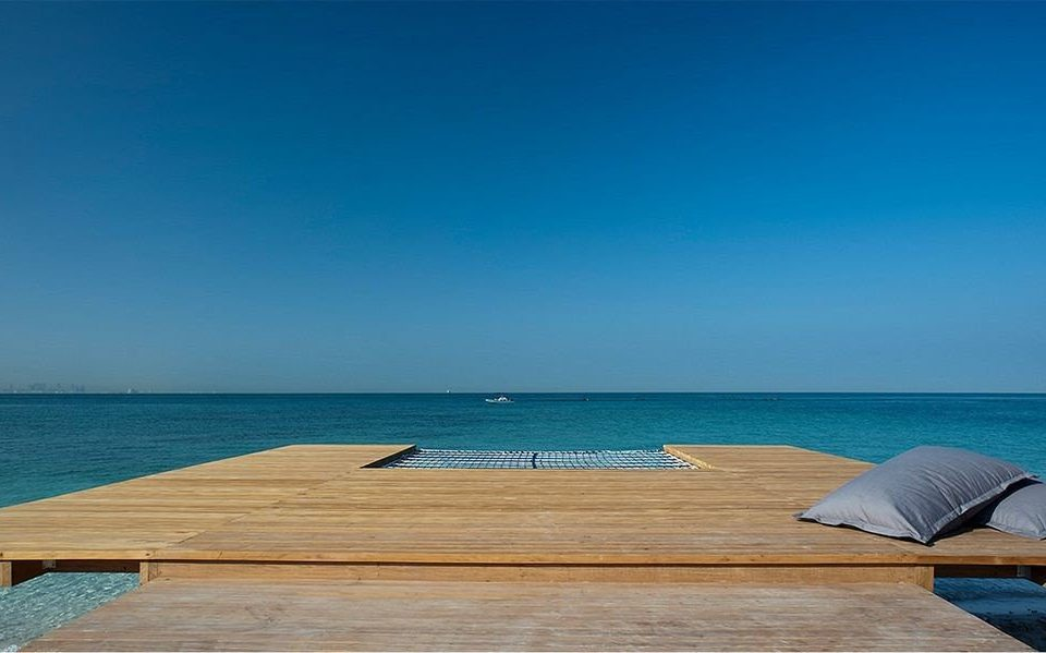 sky water Sea blue Beach shore horizon leisure Ocean swimming pool wooden Coast