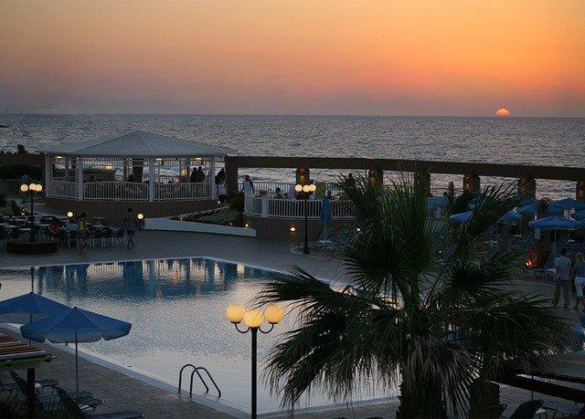 sky water Ocean Sea Sunset Beach evening Coast palm dusk marina shore lined day