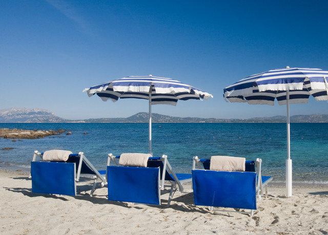 sky water chair Beach blue Sea Ocean shore Coast dock vehicle lawn marina set day sandy