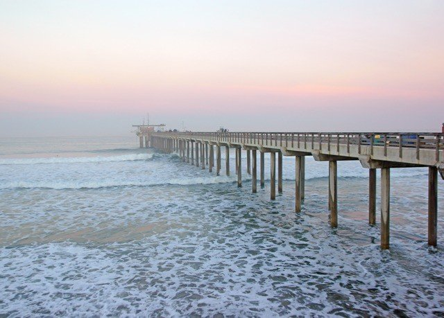 sky water pier scene shore Sea Beach Ocean walkway horizon Coast morning breakwater wave boardwalk wind wave sunrise sandy day