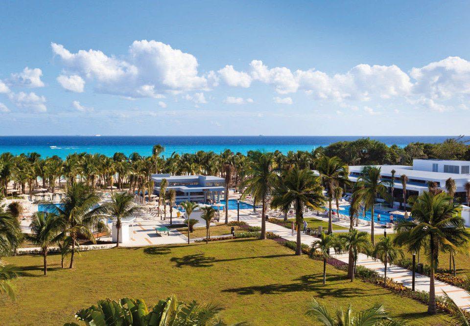 sky grass Beach leisure Resort walkway Coast caribbean boardwalk Sea marina dock shore plant lush day