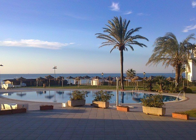 sky palm property Resort walkway Beach marina boardwalk dock Sea arecales Coast swimming pool Villa shore