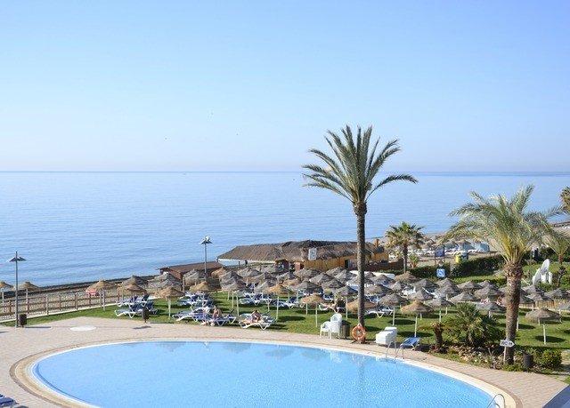 sky Resort property swimming pool Beach Sea Coast condominium marina Villa caribbean reef shore