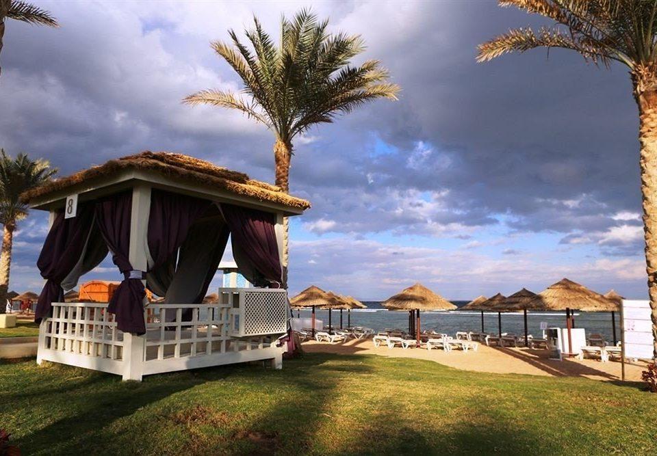 grass tree property house home Resort Villa Coast mansion Beach lawn Sea cottage palm plant
