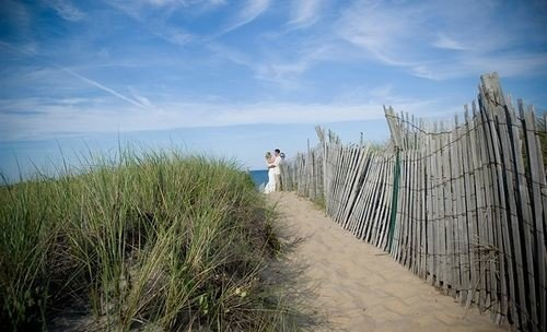 sky habitat natural environment Coast horizon Sea grass walkway prairie grass family Beach sand boardwalk wind plant day