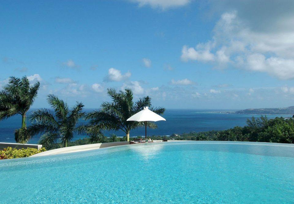 Country Luxury Pool Villa sky water tree swimming pool Nature property caribbean Resort Sea Lagoon Beach Ocean blue reef Island shore swimming day