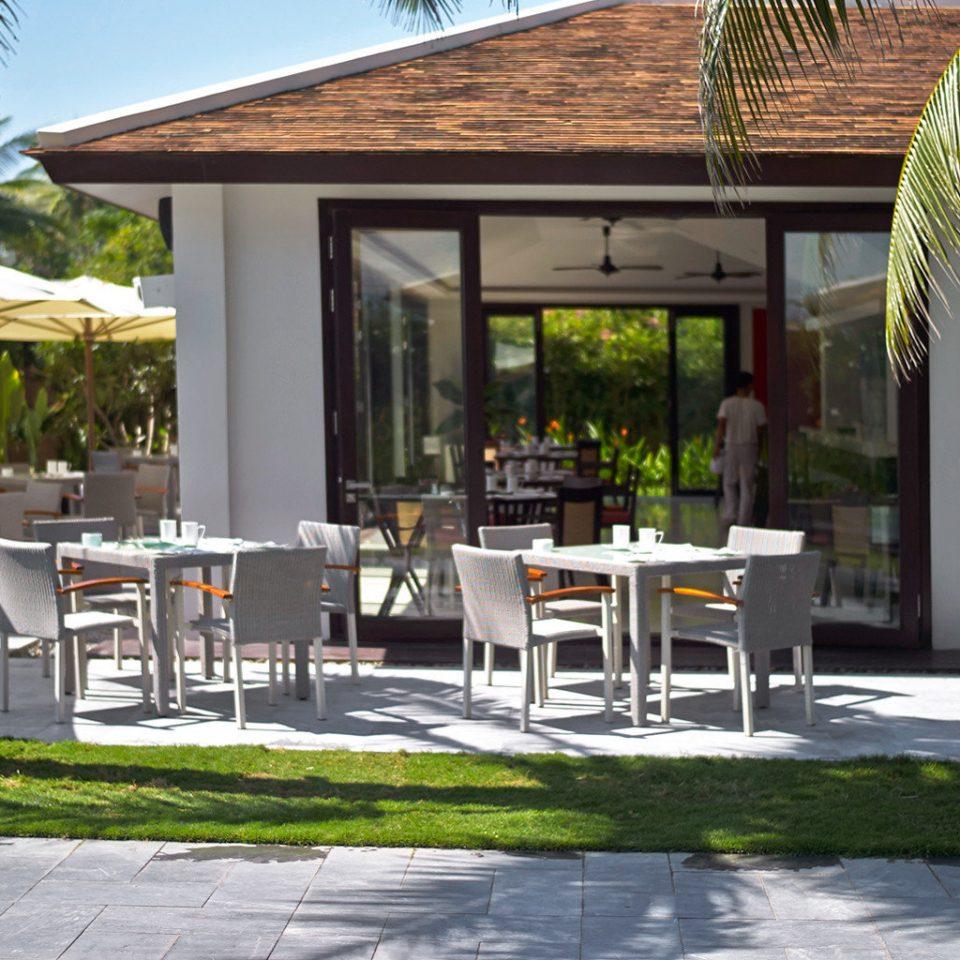 Beach Dining Drink Eat Jungle Luxury Modern Ocean Outdoors Patio Resort Tropical Waterfront Wellness building property porch outdoor structure restaurant home backyard cottage Villa pergola Courtyard house Deck