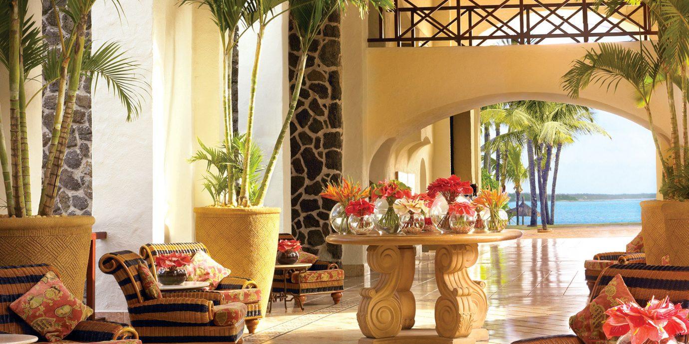 Beach Honeymoon Island Lobby Luxury Romance Romantic Tropical Waterfront property living room home porch Resort Courtyard Villa mansion hacienda outdoor structure condominium backyard