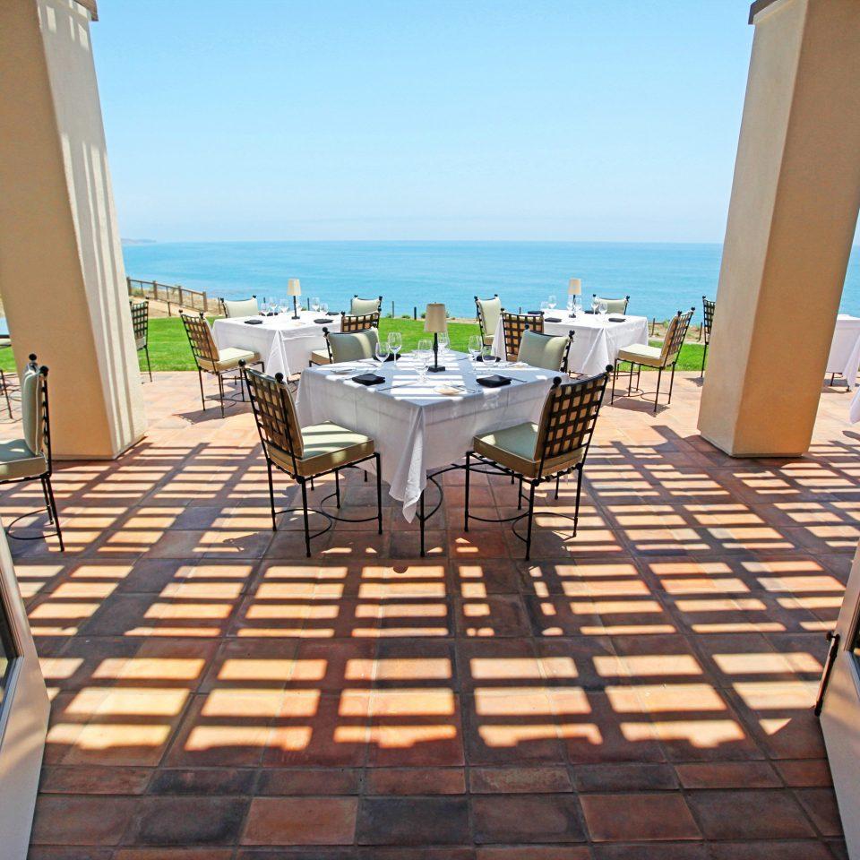 Dining Drink Eat Eco Ocean Romantic Scenic views sky chair water leisure property Beach Resort Villa walkway caribbean condominium lawn Deck porch overlooking shore