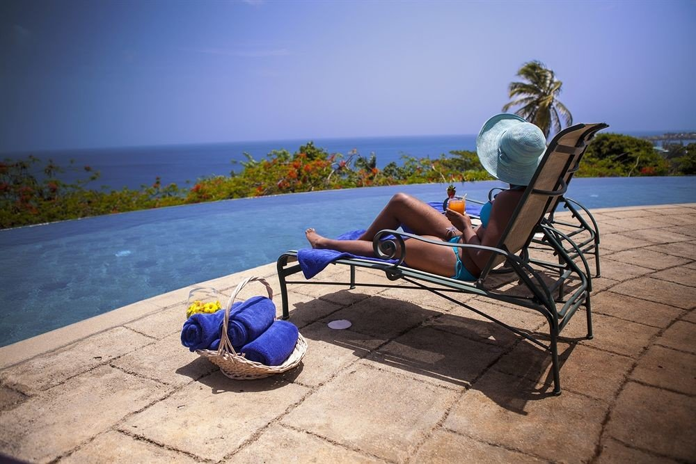 Deck Dining Pool Scenic views sky ground leisure human positions sitting blue chair swimming pool Beach Sea