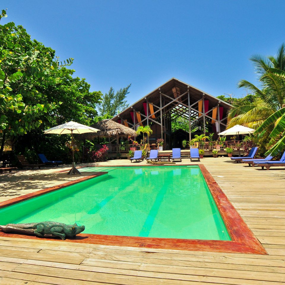 Deck Eco Island Jungle Pool tree sky leisure swimming pool Resort Beach caribbean tropics walkway backyard Villa colorful Water park