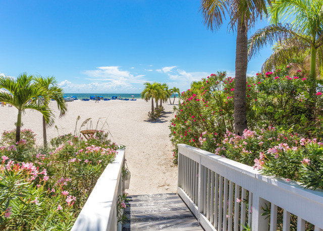 tree sky property palm walkway building Resort Beach arecales porch flower Villa plant caribbean Garden Deck lined