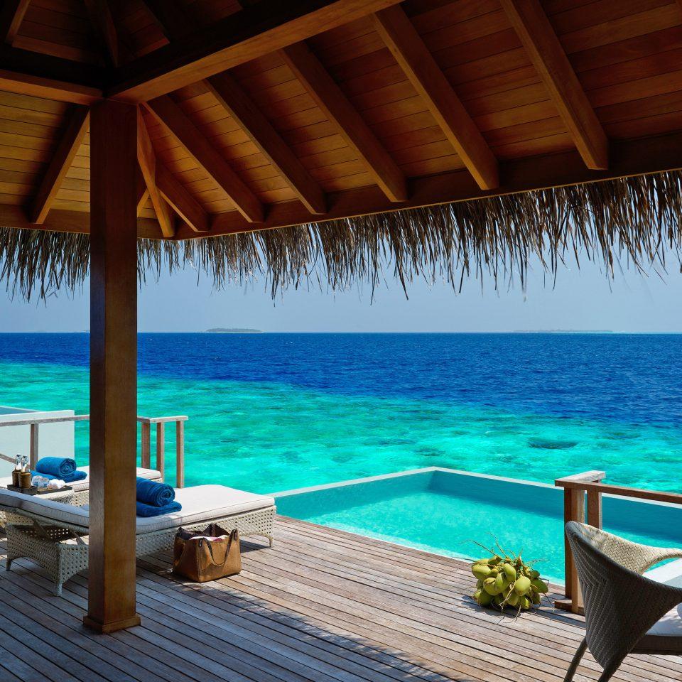 Grounds Honeymoon Luxury Pool Resort Romance water umbrella chair swimming pool Beach leisure property caribbean lawn Ocean Sea Villa swimming overlooking Deck shore